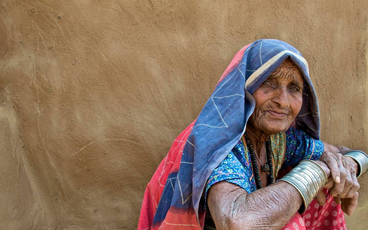In a desert village in Indian, the matriarch watches as visitors arrive.
