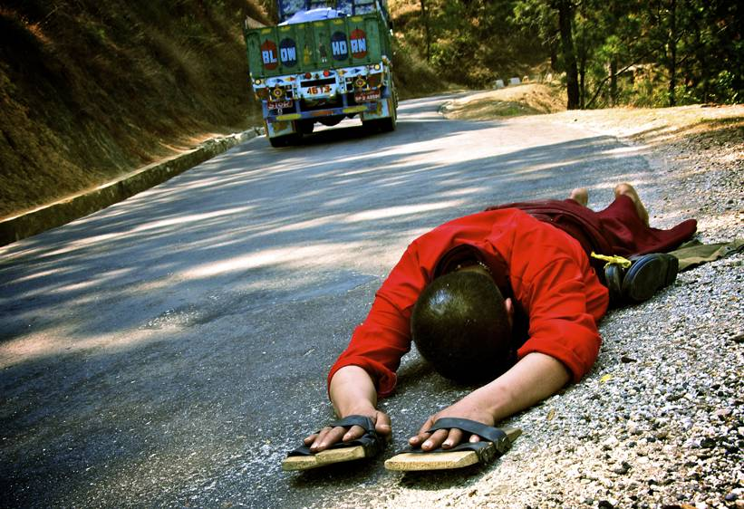 In Bhutan, acts of faith can be found around every corner. This Bhuddist monk felt called to walk and prostrate along 160 miles of winding road from Paro to Panukha. He prostrated 12  hours a day for 30 days.