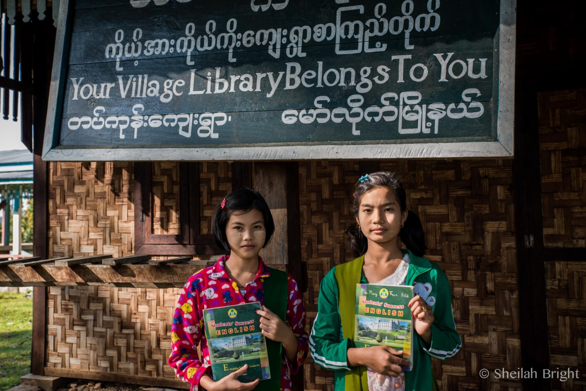 Girls show off their English books in a village along the Chindwin River in Myanmar.