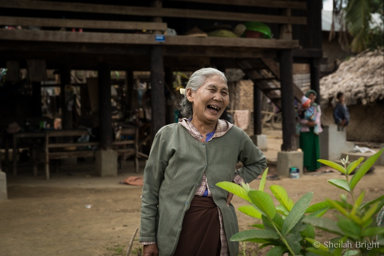 In a small village along the Chindwin River in Myanmar, a woman laughs at the idea of being photographed.