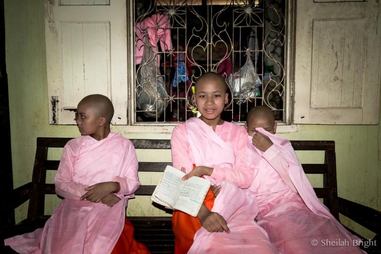 At a nunnery near Mandalay, girls wait for their teacher.