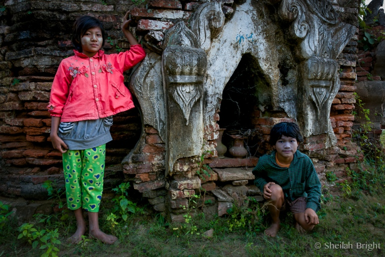 Children play among 16th century ruins of the Inwa kingdom near the Sutaungpyay compound along Myanmar's Chindwin River.