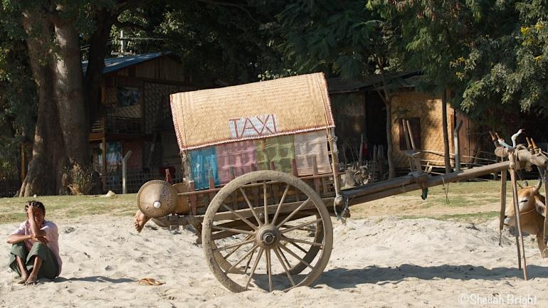 In Mingun, Myanmar, a taxi driver transforms his ride into a nap mobile.